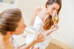 Girls drinking champagne Royalty Free Stock Photography