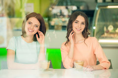 Girls drinking coffee Royalty Free Stock Images