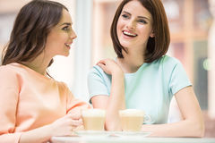 Girls drinking coffee Royalty Free Stock Image
