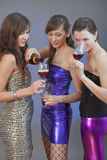 Girls drinking on disco Royalty Free Stock Photography