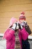 Girls drinking hot drink in snow Stock Image