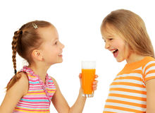 Girls drinking juice Royalty Free Stock Images
