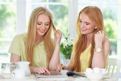 Girls  drinking tea  with magazine Stock Photography