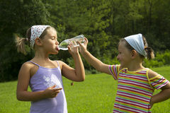 Girls drinking water Royalty Free Stock Images