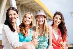 Girls with drinks on the beach Stock Image