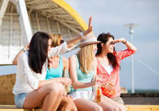 Girls with drinks on the beach Royalty Free Stock Photography