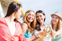 Girls with drinks on the beach Stock Photo