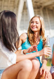 Girls with drinks on the beach Royalty Free Stock Photos
