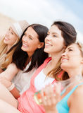 Girls with drinks on the beach Stock Photography
