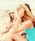 Girls with drinks on the beach Stock Photos