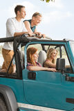 Girls driving off-road vehicle Stock Photos