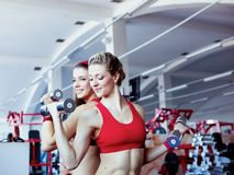 Girls with dumbbells in fitness center Royalty Free Stock Image