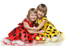 Girls with Easter basket sitting on the floor Royalty Free Stock Photography