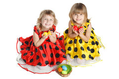 Girls with Easter basket sitting on the floor Royalty Free Stock Image