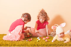 Girls on an Easter Egg hunt Stock Photos