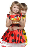 Girls with Easter eggs in a basket Royalty Free Stock Images
