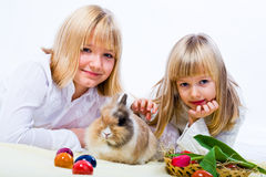 Girls and eastern rabbit Royalty Free Stock Images