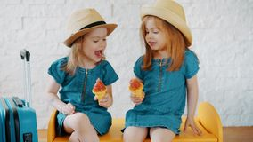 Girls eat ice cream at home while waiting for a summer. Two little girls eat ice cream at home while waiting for a summer vacation stock footage