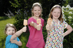 Girls eat popsicle Stock Photography