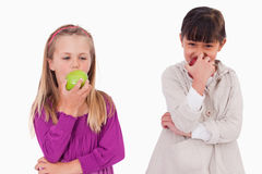Girls eating apples Royalty Free Stock Images