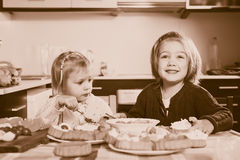 Girls eating cakes Stock Images