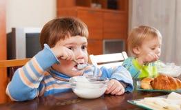 Girls eating dairy breakfast Stock Photo