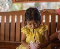Girls are eating delicious ice cream. Closeup Girls are eating delicious ice cream stock photos
