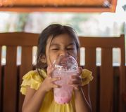 Girls are eating delicious ice cream. Closeup Girls are eating delicious ice cream royalty free stock photo