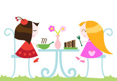Girls eating dinner Royalty Free Stock Photography