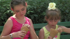 Girls eating ice cream on the street in Varna, Bulgaria. Varna - the sea capital of Bulgaria, a center of shipping and tourism. Today it is the third largest and stock footage