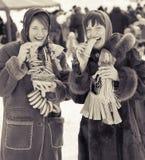 Girls  eating pancake during  Shrovetide Royalty Free Stock Image