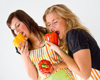 Girls Eating Paprika Royalty Free Stock Images