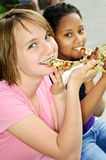 Girls eating pizza stock photos