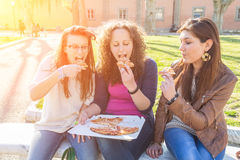 Girls Eating Pizza Royalty Free Stock Photo