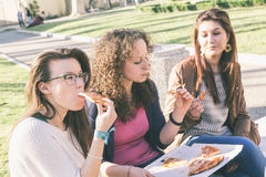 Girls Eating Pizza Royalty Free Stock Photography