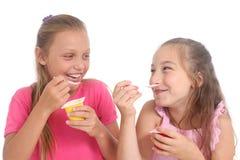 Girls eating yogurt Royalty Free Stock Photography