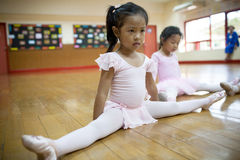 Girls in elementary school, take a course of classical dance. Stock Photos