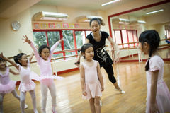 Girls in elementary school, take a course of classical dance. Royalty Free Stock Photo
