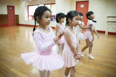 Girls in elementary school, take a course of classical dance. Royalty Free Stock Images