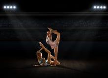 Girls engaged art gymnastic at sports hall Stock Image