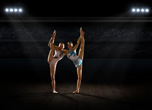 Girls engaged art gymnastic at sports hall Stock Photo