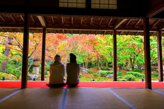 girls enjoy fall color at Enkoji, Kyoto Stock Photo