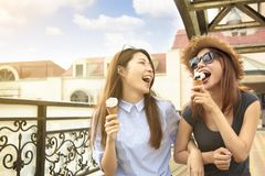 girls enjoy ice cream and summer vacations royalty free stock image