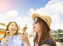 girls enjoy ice cream and summer vacations stock image