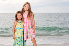 Girls enjoy summer day at the beach. Stock Image