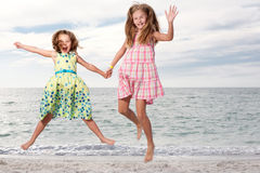 Girls enjoy summer day at the beach. Royalty Free Stock Photo