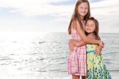 Girls enjoy summer day at the beach. Royalty Free Stock Photos