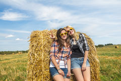 Girls enjoy sunny day together in countryside Stock Photo