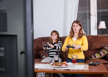 Girls enjoy the tv game Stock Images