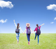 girls enjoy vacation and tourism with cloud background Stock Photo